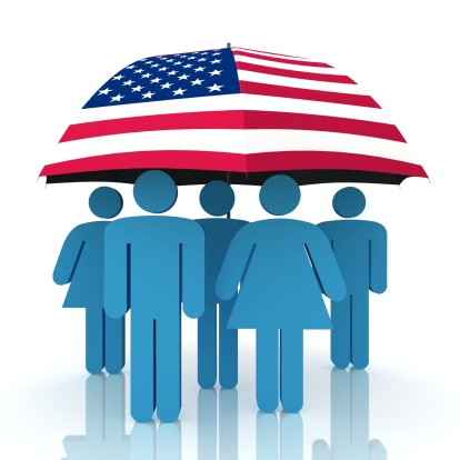 American flag umbrella covering people