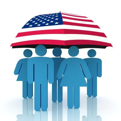 American flag umbrella covering people
